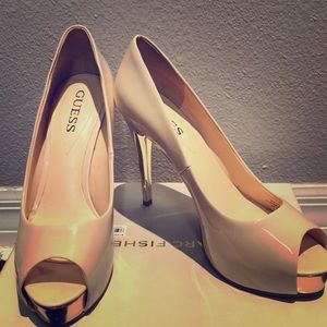 Nude Guess Heels with Gold tips and heel.